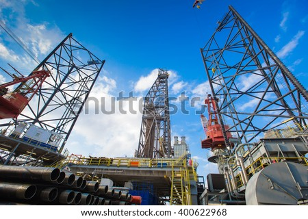 Oil and gas drilling rig work over remote wellhead platform to completion oil and gas produce well by using drilling bit which made from carbide or diamond at head bit and drive by mud pressure - stock photo