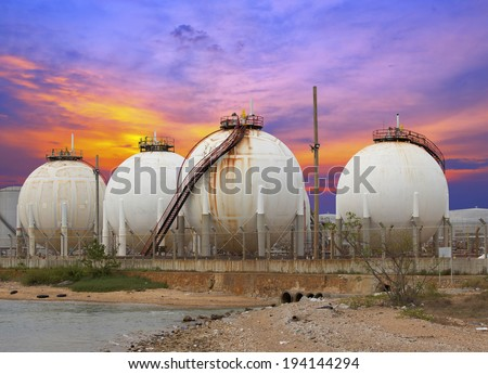 Oil and gas industry - Petrochemical factory, Industrial zone and petrochemical plant at sunset - stock photo