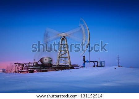 Oil and gas industry. Pump jack at blue sky background. - stock photo