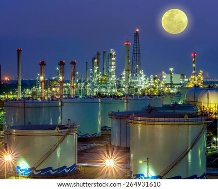 Oil and gas industry - refinery at night full moon - factory - petrochemical plant - stock photo