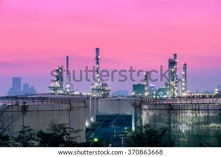 Oil and gas industry - refinery at sunset - factory - petrochemical - stock photo