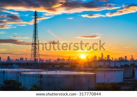 Oil and gas industry - refinery at sunset - factory - petrochemical plant - stock photo