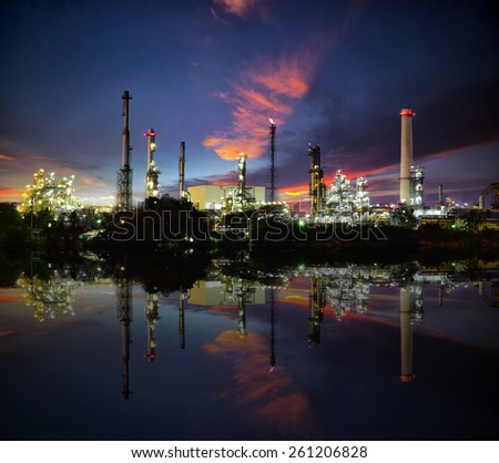 Oil and gas industry - refinery at sunset with reflection on water - factory - petrochemical plant - stock photo