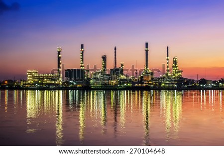 Oil and gas industry - refinery at twilight - factory - petrochemical plantwith reflection over the river - stock photo