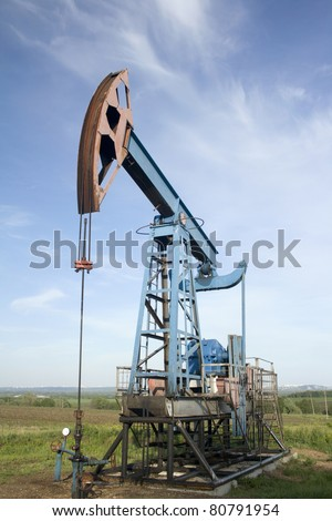 Oil and gas industry. Work of oil pump jack on a field. Environment damage