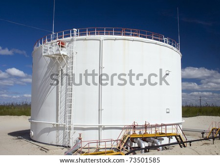 Oil and gas industry. Work of oil pump jack on a oil field. Oil reservoir on a petrochemical plant - stock photo