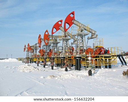 Oil and gas industry. Work of oil pump jack on a oil field. Winter extraction of oil. Oil industry of West Siberia  - stock photo