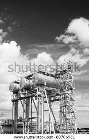 Oil and gas industry. Work of refinery petrochemical plant. Oil reservoir and storage tank of mineral oil. Black and white photo - stock photo