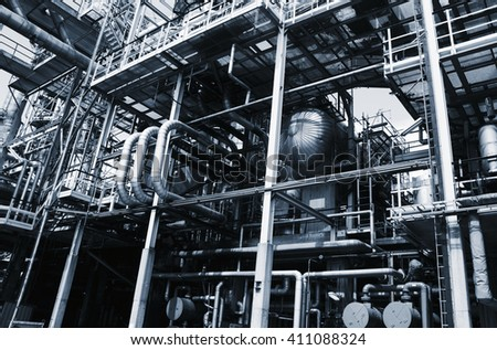 oil and gas installations, pipelines and pumps, metal blue toning idea - stock photo