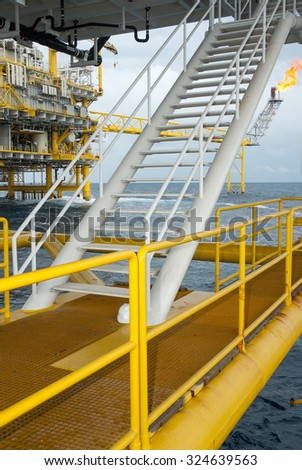 Oil and gas platform in the gulf or the sea.