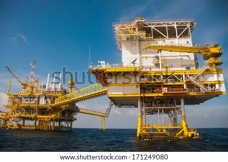 Oil and gas platform in the gulf or the sea, The world energy, Offshore oil and rig construction.Platform for production oil and gas. - stock photo