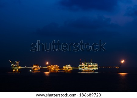 Oil and gas production platform in night time in Gulf of Thailand, South East Asia - stock photo