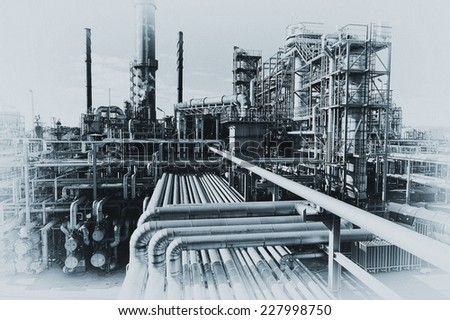 oil and gas refinery in old fashioned processing, fading borders - stock photo
