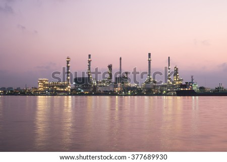 oil and gas refinery petrochemical factory at sunset - stock photo