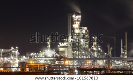 Oil and gas refinery plant at night - Petrochemical factory - stock photo