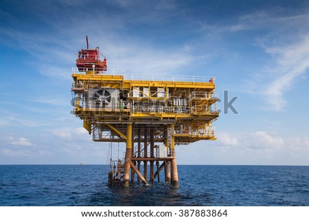 Oil and Gas remote wellhead platform for oil and gas business,looking from crew boat.  - stock photo