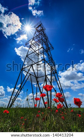 Oil and gas rig structure in rural countryside - stock photo