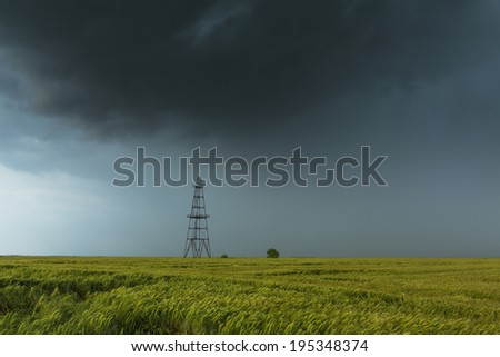 Oil and gas rig under heavy storm - stock photo