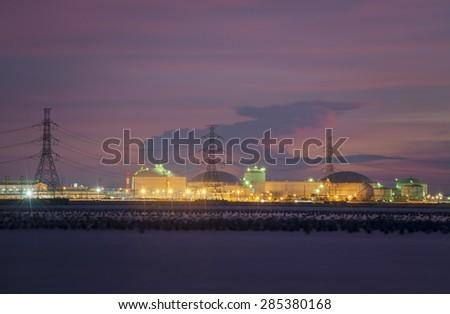 Oil and gas Storage tanks on twilight - stock photo