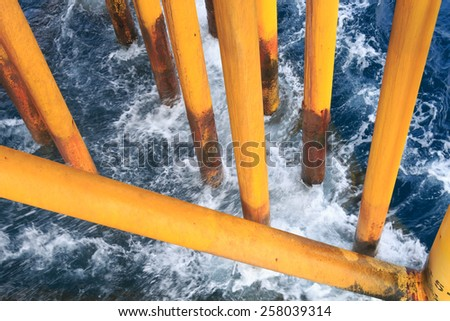 Oil and Gas Surface Casing at Offshore Platform With Ocean Wave - stock photo