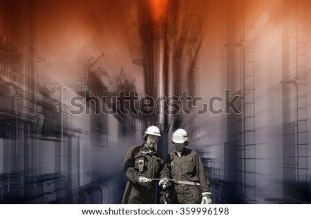 oil and gas workers with chemical oil refinery in background, safety-flame burning - stock photo