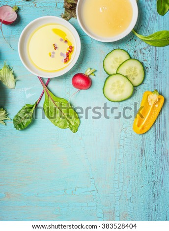 Oil and honey dressings for vegetables salad on light shabby chic blue background, top view, place for text. Healthy eating or diet food concept. - stock photo