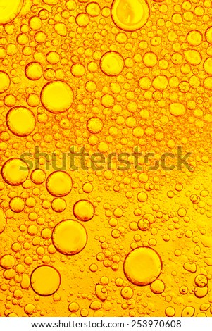 Oil and Water - Abstract Background Yellow  Macro - stock photo