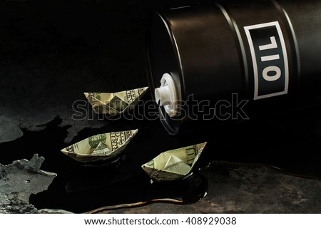 Oil business concept. The ships of the dollars floating on oil flowing out of the barrel - stock photo