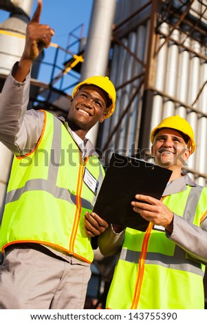 oil chemical industry workers at refinery plant - stock photo