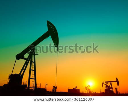 Oil derrick in work, in the field