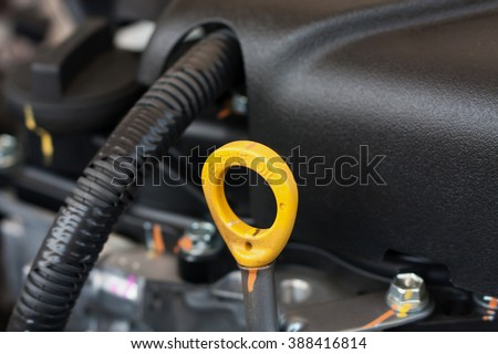 oil dipstick of car engine, check oil level - stock photo