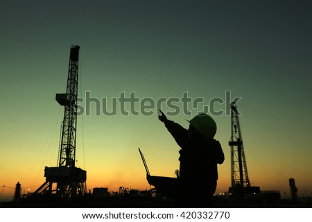Oil drilling frame and exploration technician in a oilfield - stock photo