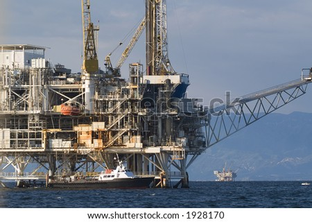 Oil Drilling Platform with Boom and another platform in background