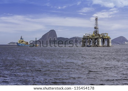 Oil drilling rig against panorama of Rio De Janeiro - stock photo
