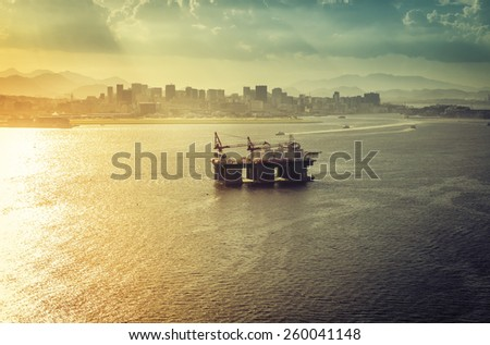 Oil drilling rig against panorama of Rio De Janeiro, Brazil - stock photo
