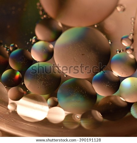 Oil drops on a water surface. Beautiful colorful abstract background. - stock photo