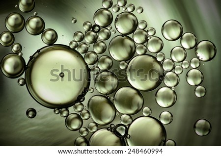 oil drops on the water surface - stock photo