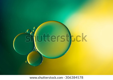 Oil drops on water surface, abstract macro background. - stock photo