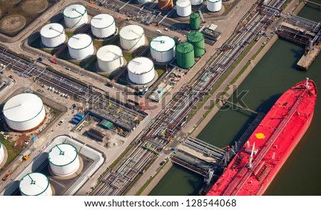 Oil drums in a port - stock photo