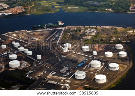 Oil farm with river in Newark, New York