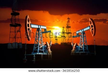 Oil field at sunset. - stock photo