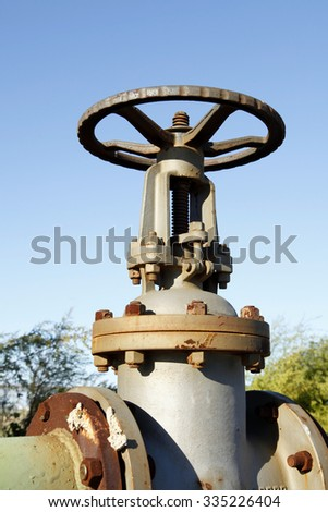 Oil field piping and valves, close-up