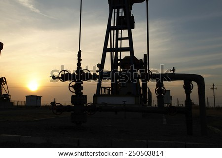 Oil field scene, oil pipelines and facilities - stock photo