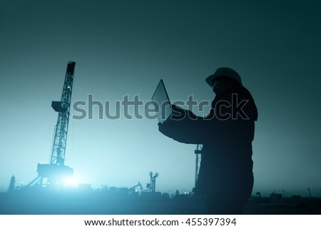 oil field, the oil worker working - stock photo