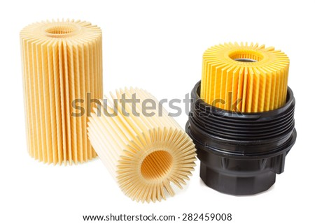 oil filter and insert the engine oil filter with housing - stock photo
