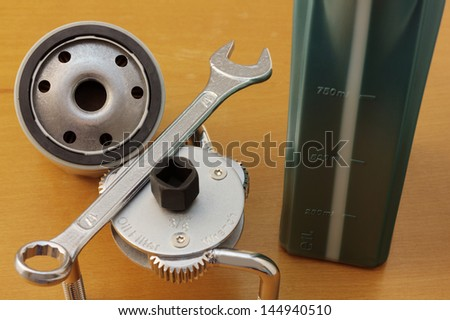 Oil filter, filter wrench and other tools for oil-change. - stock photo