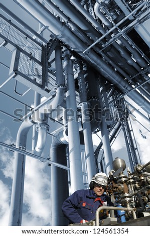 oil, fuel and gas works, refinery worker with pipelines machinery - stock photo