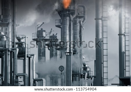 oil, gas and fuel installation, burning safety flames in middle tower, blue toning concept - stock photo