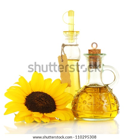 oil in jars and sunflower, isolated on white - stock photo