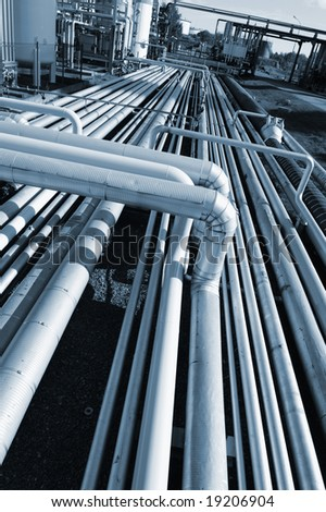 oil industrial pipelines inside refinery, blue toning concept